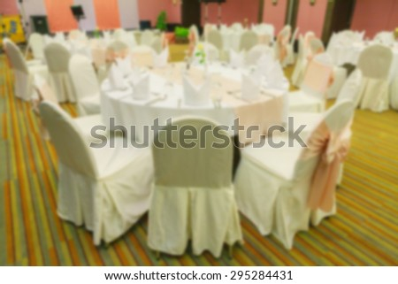 Blurred dining table in the banquet hall made with vintage color. - stock photo