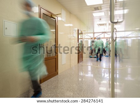 "Blurred doctor figures wearing medical uniforms are seen in the governmental hospital ""Lozenets"" corridor in Sofia, Bulgaria, June 1, 2015."