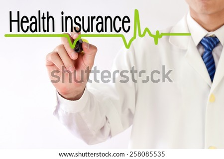 Blurred Doctor writing Health insurance concept - stock photo