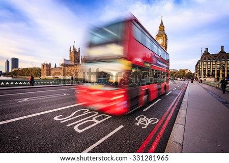 Blurred double decker red bus with Westminster and Big Ben on background in London, Uk. - stock photo
