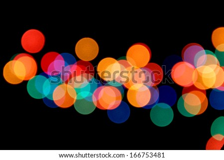 Blurred electric lights on black background
