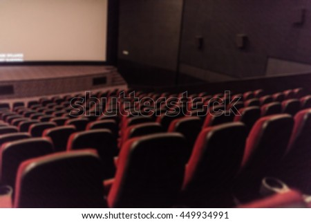 Blurred empty red cinema seats from back background.