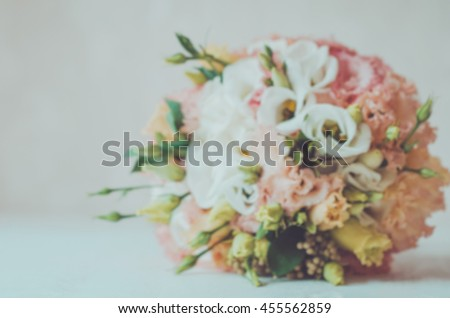 Blurred floral autumn background bridal bouquet of wedding flowers roses. Rustic style. Fall gold Marriage. Natural floral, vintage toned. Text, copy space. - stock photo