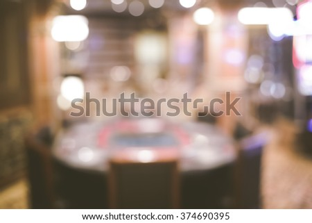 Blurred focus game table in casino with Instagram style filter. - stock photo