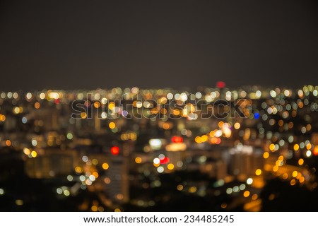 Blurred focus of big city in night time - stock photo