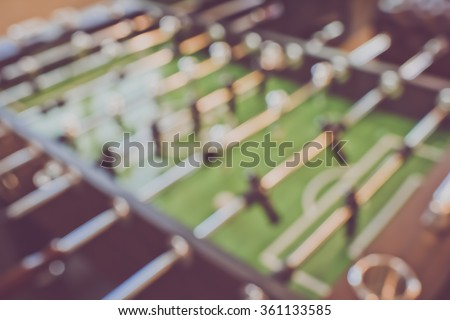 Blurred Foosball Table with vintage instagram style filter - stock photo