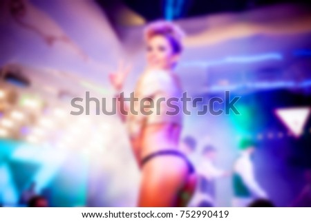 Blurred for background. night club Go go dancer. Dance show at night club with lights show and club smog. Performance show during night party.