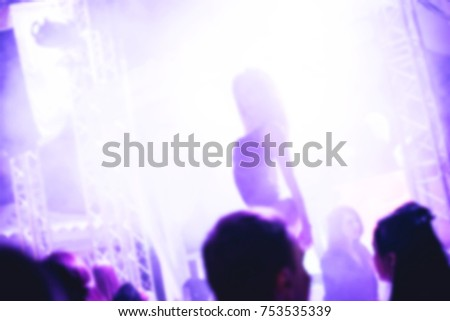 Blurred for background. night club Go go dancer. Dance show at night club with lights show and cub smog. Performance show during night party.