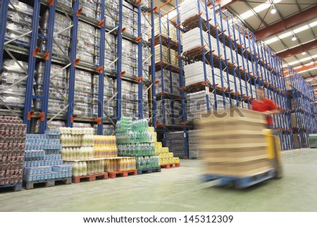 Blurred forklift driver warehouse - stock photo