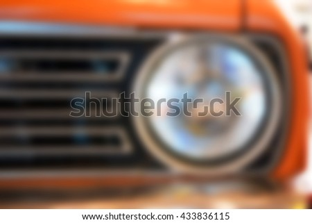 Blurred front of old car - stock photo
