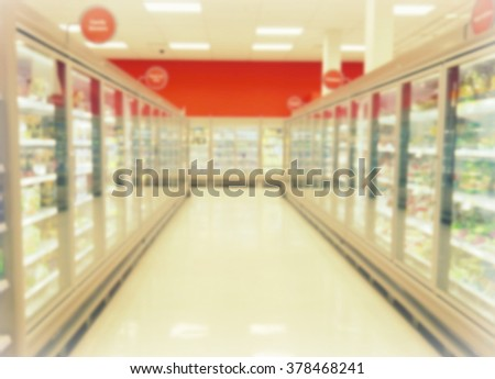 Blurred frozen food aisle at a supermarket  - stock photo