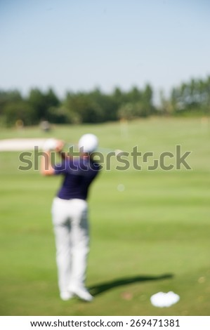 blurred golfers hit sweeping and keep golf course in the summer for relax time - stock photo