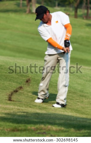 blurred golfers hit sweeping and keep golf course in the summer for relax time