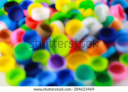 blurred group of multicolored bottle caps