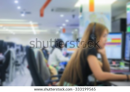 Blurred group of operator help-desk working on computer with headset:blur women operator talking for helping customers:working employees giving information:blur working women concept. - stock photo