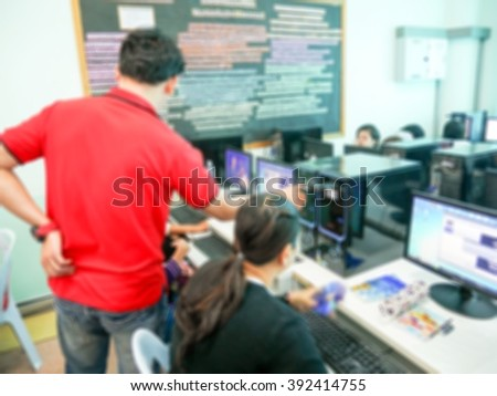 blurred group of students learning at computer laboratory computer - stock photo