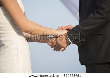 Blurred Hands newly married about wedding rings