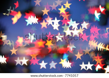 Blurred holiday background with star-shaped highlights. - stock photo