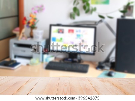 Blurred home interior of desk  with wooden surface - stock photo
