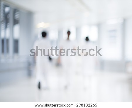 Blurred hospital and staff for background  - stock photo