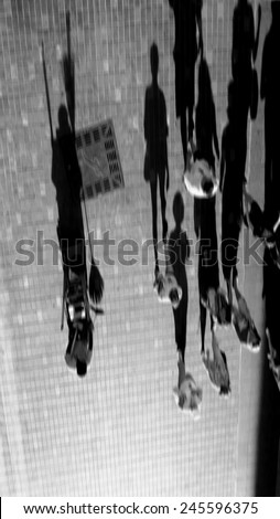 Blurred image abstract human shadow walk in the city. black and white design for background. - stock photo