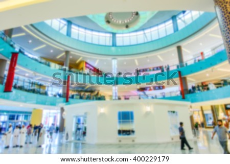 Blurred image inside shopping mall of Dubai. Blur supermarket in UAE.