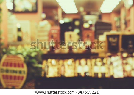 Blurred image of a wine shop.  Polaroid effect. Wine shop background. - stock photo