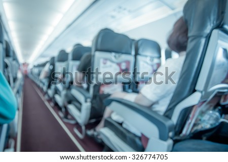 Blurred image of airplane interior in cabin,blue color filter