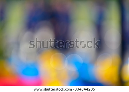 Blurred image of an amateur orchestra performing at park  - stock photo