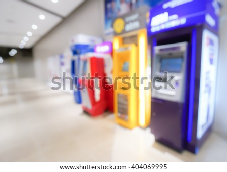 Blurred image of atm machines at department store  - stock photo