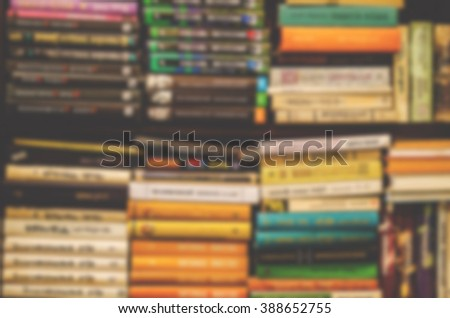 Blurred image of books on bookshelf. Bookstore background. Retro effect.
