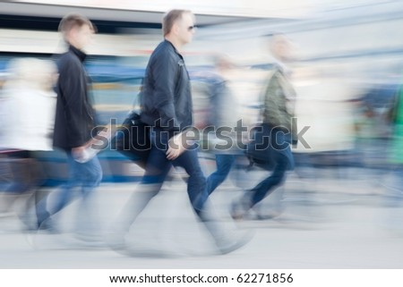 Blurred image of business people rushing to work in the morning - stock photo