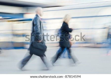 Blurred image of businessman rushing to office in the morning - stock photo