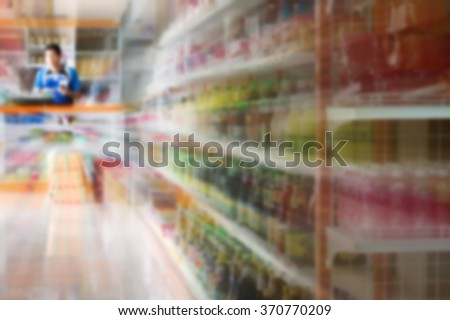 Blurred image of cash-desk with cashier and terminal in supermarket - stock photo