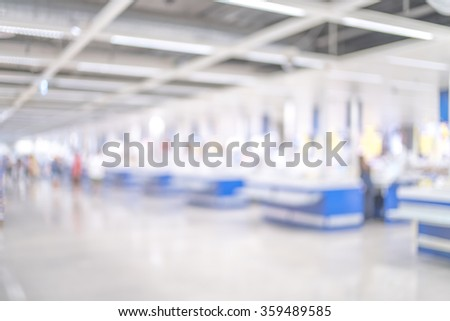 Blurred image of Cashier counter in supermarket store for background uses. - stock photo
