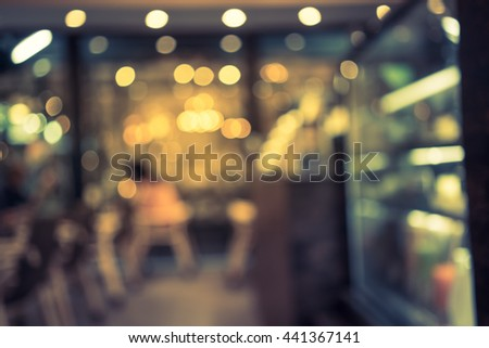 blurred image of coffee shop with bokeh, vintage color - stock photo