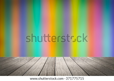 Blurred image of colorful wooden background with white wooden under for put your products. - stock photo