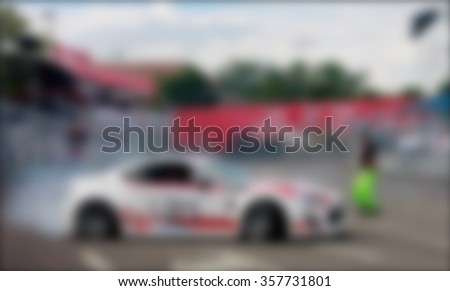 blurred image of drifting car show - stock photo