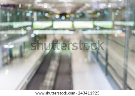 Blurred image of escalator walk way in Airport terminal. - stock photo