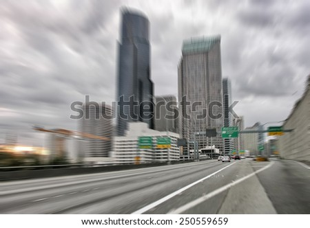 Blurred image of fast moving cars approaching Seattle. - stock photo
