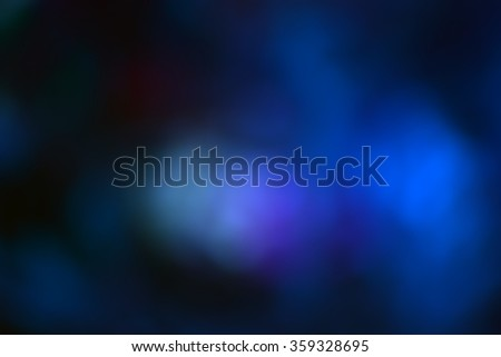 Blurred image of festive lights that can be used as background. Blurred colored light bulbs, ocean, sea. Bokeh. Ice with colored lights. - stock photo