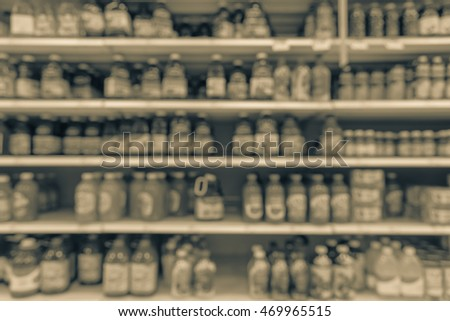 Blurred image of fuzzy drinks aisle in American supermarket. The affordability and wide variety of sugary drinks contribute to the growing obesity problem in the U.S. Drink bottles display on shelves.