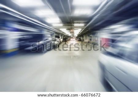 Blurred image of interior of car garage. - stock photo