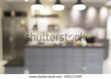 Blurred image of kitchen interior for background uses. - stock photo