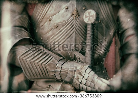 Blurred image of knight armor in vintage style - stock photo