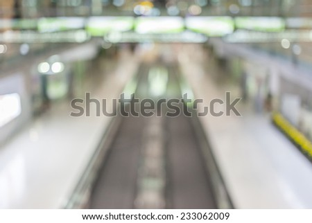 Blurred image of moving escalator walk way in Airport terminal. - stock photo