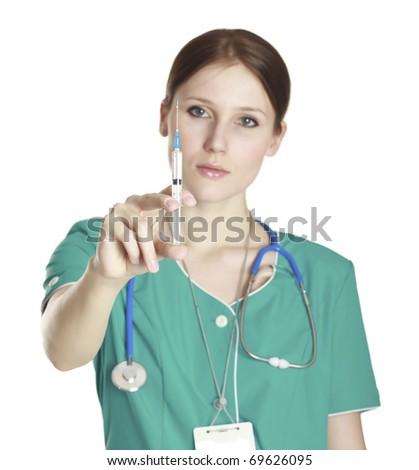 Blurred image of nurse holding syringe in hand on white background - stock photo
