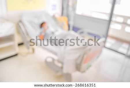 blurred image of Patient with drip in hospital for background usage. - stock photo