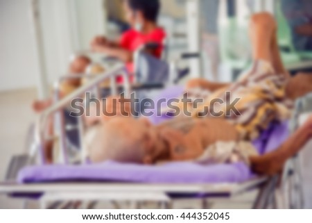Blurred image of  patients waiting for treatment at the hospital.