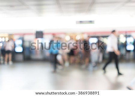 Blurred image of people at train station for background use - stock photo